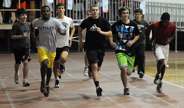 Beverly:<br /> The winter track team practices in the Beverly High School Fieldhouse. This is the first day of Beverly High winter sports practices.<br /> Photo by Ken Yuszkus/Salem News, Monday November 30, 2009.