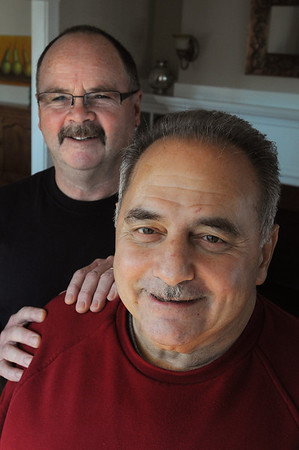 Lynn:<br /> Firefighter John Salvanelli, left, saved heart attack victim George Besheres, right, <br /> Photo by Ken Yuszkus/Salem News, Tuesday, January 10, 2012.