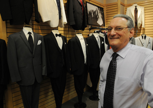 Danvers:<br /> Larry Levine, manager of Men's Warehouse at Liberty Tree Mall, stands near tuxedos that the store rents.<br /> Photo by Ken Yuszkus/Salem News, Monday, May 14, 2012.