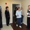 Hamilton:<br /> From left, Lori Morency, Lorraine Pesce, Shirley Flynn, Dick Flynn, listen to Linda Pierce, assisstant site manager for Haborlight Community Partners, answer questions while leading a tour of one of the apartments in Firehouse Place. Just opened, Firehouse Place is a new housing project in Hamilton with a nonprofit food pantry on the first floor and several affordable housing apartments.<br /> Photo by Ken Yuszkus/Salem News, Monday, November 14, 2011.