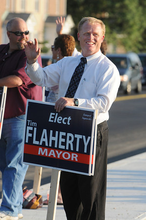 Beverly:<br /> Tim Flaherty, who is a mayoral candidate, waves to Beverly voters in front of Beverly High School. <br /> Photo by Ken Yuszkus/Salem News, Monday, September 12, 2011.