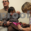 Beverly:<br /> Anna Hollesen, 2 years old, receives a H1N1 flu shot from nurse Jean Sciamanna while Anna's father, Kai Hollesen, holds her in his lap.<br /> Photo by Ken Yuszkus/Salem News, Tuesday November 3, 2009.