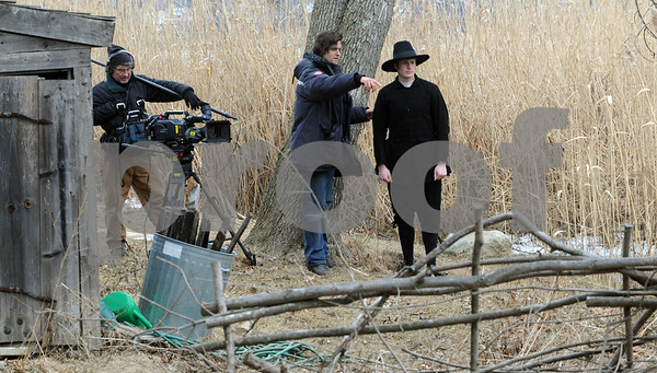 Salem:<br /> From left, Tom Williams, soundman, and Tim Cragg, director of photography, who is instructing actor Benjamin Drake where to walk for the shoot. WGBH is shooting a documentary on the history of religion and is using Pioneer Village to shoot a couple of scenes and reenactments.<br /> Photo by Ken Yuszkus/Salem News, Thursday,  February 26, 2009.