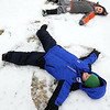 Hamilton:<br /> From foreground to background are George Russo , Jackson Maidment, both of of Hamilton, and Sofija Ryan of Wenham. They are making snow angels in the snow at Patton Park during their playtime. They are with the kindergarten enrichment class at the Northshore YMCA Hamilton site. The snow may not last too much longer with the predicted warm temperatures coming the next few days.<br /> Photo by Ken Yuszkus/Salem News, Monday, January 23, 2012.