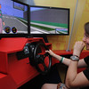 Beverly:<br /> Haley Sciolo reacts to striking an imaginary pedestrian while using the driving simulator.<br /> Photo by Ken Yuszkus/Salem News, Monday, July 11, 2011.