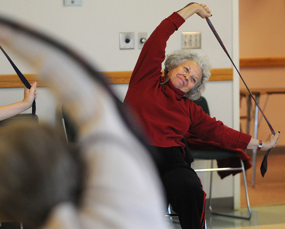 Danvers:<br /> Ellen Lederman uses a tie during the chair yoga class at the Danvers Council on Aging on Monday afternoon.<br /> Photo by Ken Yuszkus/Salem News, Monday, January 9, 2012.
