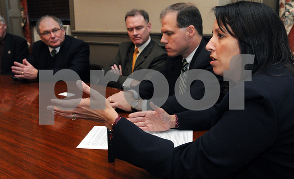 Salem:<br /> Salem Mayor Kim Driscoll, right, announces a multi-year tax agreement with Dominion at city hall. Listening, from left, is Gary Courts, managing director of Dominion Energy of New England, Daniel Weekley, managing director of northeast government affairs at Dominion, and John Keenan, state representative. Dominion is the city's largest taxpayer.<br /> Photo by Ken Yuszkus/Salem News, Wednesday December 3, 2008.