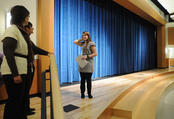 Beverly:<br /> Lauren Leclerc, student, speaks to one of the tour groups while on the stage in the renovated auditorium after the ribbon cutting ceremony for the new Beverly High School on Friday morning.<br /> Photo by Ken Yuszkus/Salem News,  Friday,  November 19, 2010.