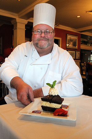 Salem:<br /> Steve Nelson, Executive Chef at the Hawthorne Hotel, displays a gingerbread sandwich at the hotel.  The gingerbread sandwich is the hotel's Thanksgiving recipe.<br /> Photo by Ken Yuszkus/Salem News,  Monday,  November 15, 2010.