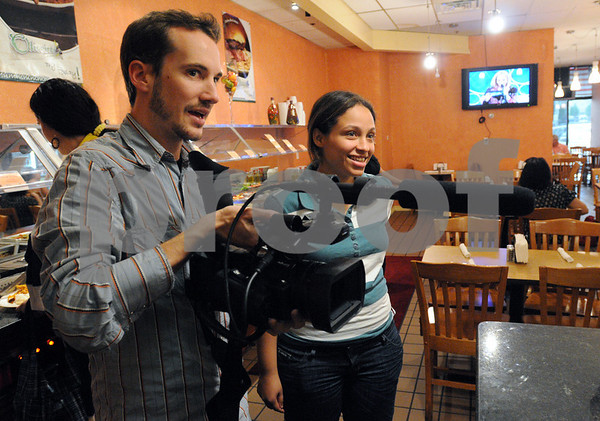 Peabody:<br /> Eliot Fisher, videographer, and Milla Araujo, producer, shoot their documentary film at Olveiras Restaurant. The film is about Brazilian immigrants in the North Shore.<br /> Photo by Ken Yuszkus/Salem News, Friday May 8, 2009.