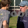 Hamilton:<br /> Hamilton-Wenham cross country coach Steve Sawyer speaks to some of the team members at practice.<br /> Photo by Ken Yuszkus/Salem News, Monday October 26, 2009.