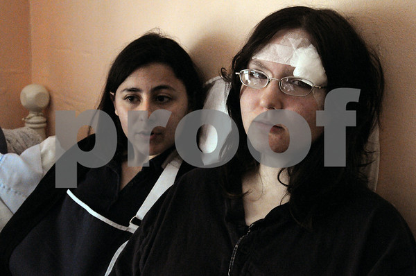 Salem:<br /> Friends Lindsay Braga, left, and Samantha Mattei were involved in the subway collision on Friday in Boston. They are now recuperating from their injuries.<br /> Photo by Ken Yuszkus/Salem News, Monday May 11, 2009.