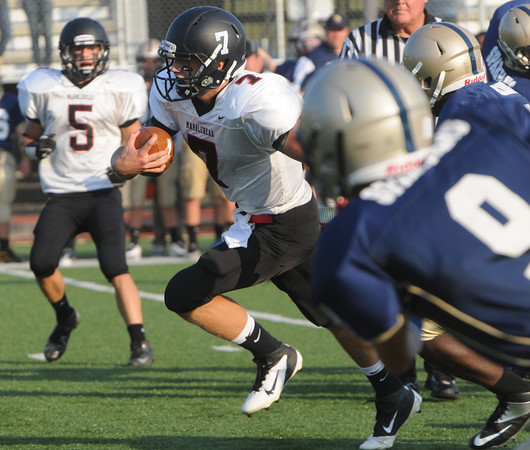 Lynn:<br /> Marblehead's Ian Maag squeezes out of the pack and makes a run during the Marblehead football game vs. St. Mary's of Lynn at Manning Field.<br /> Photo by Ken Yuszkus/The Salem News, Friday, September 14, 2012.
