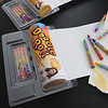 "Beverly:<br /> Marc Cooper developed his new product, ""Doodle Rolls"", a small, portable coloring kit for kids, which is a roll of drawing paper that comes with a set of crayons. <br /> Photo by Ken Yuszkus/Salem News, Friday, March 25, 2011."