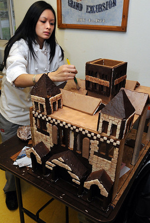 Danvers:<br /> Dung Kim Nguyen adds coloring to the ouside of a model of Trinity Church. NSCC culinary students are preparing a giant Copley Square for display in Boston.<br /> Photo by Ken Yuszkus/Salem News, Monday November 30, 2009.