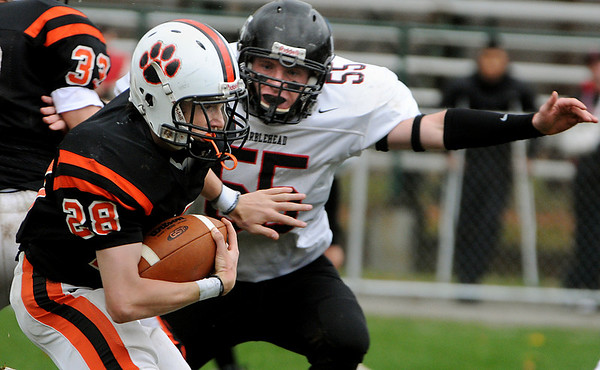 Beverly:<br /> Marblehead's Tyler Bates, right, closes in on Beverly's Kenny Pierce during the Marblehead at Beverly football game in Hurd Stadium on Saturday.<br /> Photo by Ken Yuszkus/Salem News,  Saturday,  November 6, 2010.
