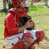 Salem;<br /> Catcher/captain Teaghan Malionek at the Salem High baseball scrimmage with North Reading.<br /> Photo by Ken Yuszkus/Salem News, Thursday, April 5, 2012.