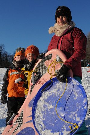 Beverly:<br /> From left, Samuel Frederick of Beverly, friend of Liam Romer, and Liam's mother, Kim Indresano, both of Salem. They were sledding at Lynch Park.<br /> Photo by Ken Yuszkus/Salem News, Tuesday, December 22, 2009.
