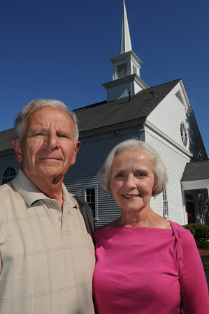 Topsfield:<br /> Vince and Jolene Guerra stand in front of the St. Rose of Lima church in Topsfield where the VOTF, a lay Catholic group that formed in wake of priest sex abuse scandal, held meetings 10 years ago and where the group still meets occasionally.<br /> Photo by Ken Yuszkus/The Salem News, Thursday, September 13, 2012.