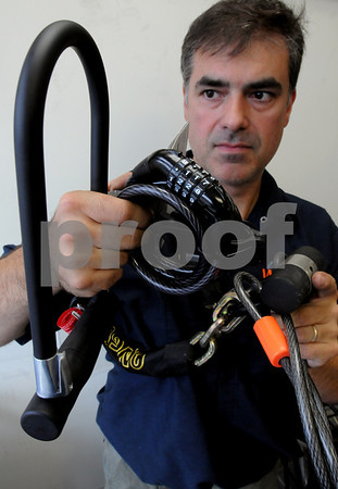 Danvers:<br /> Jamie Fisher, owner of Western Cycle, holds a variety of bicycle locks that he carries in his store. From left is a u-lock, cable lock, and a hardened steel shackle. The bicycle locks are a good investment to prevent bicycle theft.<br /> Photo by Ken Yuszkus/Salem News, Tuesday September 9, 2008.