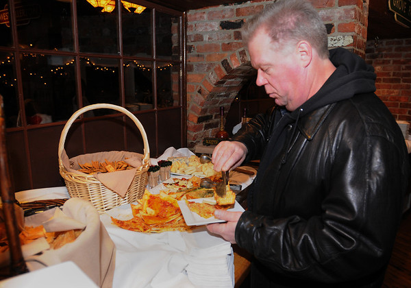 Salem:<br /> Rick LeClerc tries some of the food at the Salem Children's Charity Annual Christmas Party held at Victoria Station restaurant.<br /> Photo by Ken Yuszkus/Salem,  News, Tuesday,  December 14, 2010.