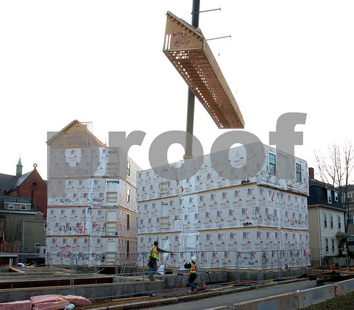 Beverly:<br /> Raising one of the prefabricated units by crane to be positioned on top of the others at Montserrat College of Art. This was the last unit raised on Tuesday afternoon.<br /> Photo by Ken Yuszkus/Salem News, Tuesday December 2, 2008.