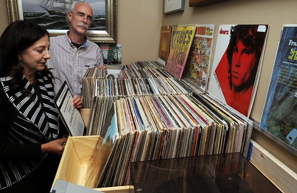 Salem:<br /> Jacquie Satin, manager, and Bob Magro, owner of Pickering Wharf Antiques Gallery, with the recently acquired LPs at the store.<br /> Photo by Ken Yuszkus/Salem News, Thursday,  October 7, 2010.