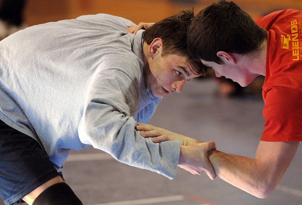 Danvers:<br /> TJ Crabtree, left, wrestles with Doug Harding during practice. TJ Crabtree is a senior wrestler at St. John's Prep who just won the Division 1 North individual tournament at 140 pounds.<br /> Photo by Ken Yuszkus/Salem News, Tuesday, February 15, 2011.