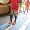 Salem:<br /> Anyssa Edwards, 5, of Salem, successfully completes the Walk the Plank Game during the Salem Public Library's summer wrapup of it's Pirate Summer for kids.<br /> Photo by Ken Yuszkus/The Salem News, Wednesday, August 22, 2012.