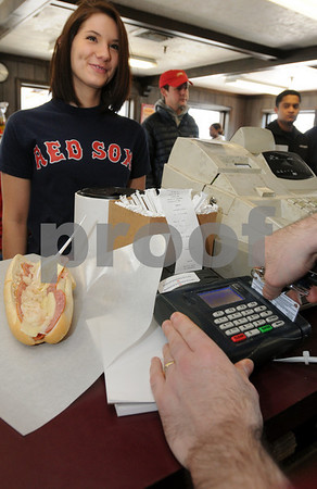 Beverly:<br /> Amanda Veliotis, a freshman at Endicott College, who lives in Berkley, Massachusetts, pays for her Italiian sub with her college swipe card at Super Subs.<br /> Photo by Ken Yuszkus/Salem News, Thursday March 5, 2009.