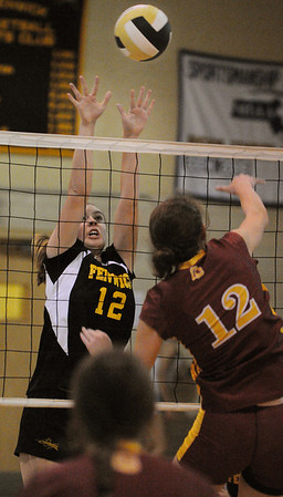 Peabody:<br /> Katherine Melanson, left, of Bishop Fenwick, reaches for the ball at the net during the Cardinal Spellman at Bishop Fenwick girls volleyball game on Tuesday.<br /> Photo by Ken Yuszkus/Salem News, Tuesday,  October 5, 2010.