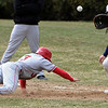 Wenham:<br /> Eastern Nazarene's Dave Rivera dives back to first base as Gordon's Ethan Davidson gets the throw during a unsuccessful pickoff try at the baseball home opener at Gordon College.<br /> Photo by Ken Yuszkus/Salem News, Wedesday, March 23, 2011.