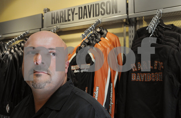 Salem:<br /> Michael Sienkiewicz, general manager of the Bruce Rossmeyer's Salem Harley-Davidson store that recently opened, stands near the leather jackets with the Harley-Davidson logo, which are part of the variety of merchandise available at the store.<br /> Photo by Ken Yuszkus/Salem News, October 7, 2008.