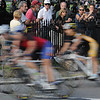 Salem:<br /> The racers of the Elite Womens race speed through the corner from South Washington Square onto North Washington Square during the Witches Cup bicycle races around the common.<br /> Photo by Ken Yuszkus/Salem News, Wednesday, August 10, 2011.