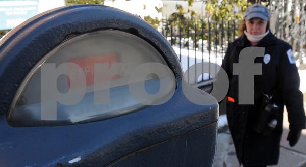 Salem:<br /> Gloria Merrill, meter maid, eyes an expired parking meter on Essex Street.<br /> Photo by Ken Yuszkus/Salem News, Wednesday March 4 2009.