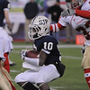 Foxboro:<br /> St. John's Prep's Luis Soto tries to get around an Everett player but has one behind ready to pounce on him at the St. John's Prep vs Everett High School in the Division 1 Super Bowl football game at Gillette Stadium on Saturday.<br /> Photo by Ken Yuszkus/Salem News, Saturday, December 4, 2010.