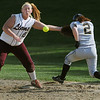 Peabody:<br /> Chelmsford's first baseman, Jill Montuori, misses the throw as Bishop Fenwick's Kim Shinnick arrives safely at first base in the Chelmsford at Bishop Fenwick softball game.<br /> Photo by Ken Yuszkus/Salem News, Friday, May 14, 2010.