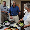 Beverly:<br /> From left, Beverly Police Chief Mark Ray, Bob Broudo, who chairs the Beverly Police Department Citizens Advisory Committee, and Carol Soper, of the Beverly Police Department Citizens Advisory Committee, chat at the food table during the Beverly Police Department Citizens Advisory Committee annual cookout at Landmark School on Tuesday.<br /> Photo by Ken Yuszkus/Salem News, Tuesday, July 12, 2011.