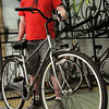 "Salem:<br /> Dan Shuman, owner of Salem Cycle, stands with a bike similar to ""The Green"" step through black bike which will used in a bike-sharing program in Salem.<br /> Photo by Ken Yuszkus/Salem News, Thursday, August 11, 2011."