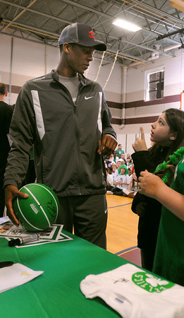Salem:<br /> Rajon Rondo, Celtics point guard, speaks with Alyssa Burke, student at the Bates Elementary School, who participated with other students in a demonstration in front of the school. Also,  Brandon Bass, Celtics forward, Bryan Doo, Celtics strength and conditioning coach, and Lucky, the Celtics mascot, were present at the program  promoting a healthy and active lifestyle.<br /> Photo by Ken Yuszkus/Salem News, Thursday,  March 8, 2012.