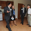 Ipswich:<br /> From left, Chris Lovasco, CEO for the YMCA of the North Shore, Elizabeth Kilcoyne, former selectman, Sam Sanker, planned gifts/major gifts director for the YMCA of the North Shore, and Bill Wasserman, former board member of the Ipswich YMCA, look over one of the apartments in Powder House Village before the ribbon cutting.<br /> Photo by Ken Yuszkus/Salem News, Thursday, August 4, 2011.