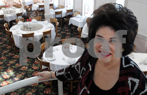 Peabody:<br /> Su Waite, owner of Su Changs restaurant, stands in one of the dinningrooms at the restaurant. Su Changs will be one of the featured eateries during Restaurant Week.<br /> Photo by Ken Yuszkus/Salem News, Wednesday, September 2, 2009.