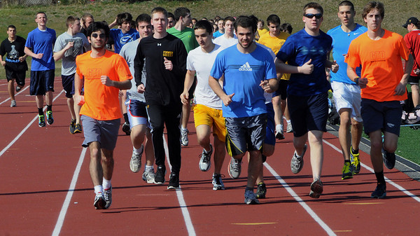 Peabody:<br /> Students run around the track at the start of the track season at Bishop Fenwick High school.<br /> Photo by Ken Yuszkus/Salem News, Monday,  March 19, 2012.