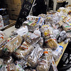 Peabody:<br /> Thomas deLangis, volunteer, carts in boxes of food to be stacked at Haven from Hunger in Peabody. Haven from Hunger is looking to expand because the space they now occupy is becoming too small for their needs.<br /> Photo by Ken Yuszkus/Salem News, Tuesday, February 15, 2011.