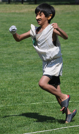 Beverly:<br /> Christian Pulido, dressed as Dobby, runs the obstacle course game called Quest For the Sorcer's Stone during the Harry Potter summer playground event at Lynch Park on Thursday.<br /> Photo by Ken Yuszkus/Salem News, Thurssday, July 14, 2011.