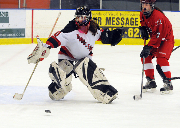 Salem:<br /> Marblehead's goalie Sabrina Doughman reaches for the puck that goes wide as Masconomet's Kendra Dow follows it in during the Marblehead vs. Masconomet girls hockey at Salem State's hockey rink.<br /> Photo by Ken Yuszkus/Salem News, Tuesday, December 27, 2011.