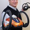 Beverly:<br /> Tom Dusenberry, president of Robonica, holds up two roboni-i. Robonica, just launched a toy robot that kids can program and it can interact with other robots. It also links up to a game online. <br /> Photo by Ken Yuszkus/Salem News, Thursday, Decmber 3, 2009.
