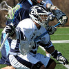 Danvers:<br /> Jim O'Connell, of St. John's Prep, runs with the ball as Peabody's Greg Shidler swings his stick around the front of Jim O'Connell during the Peabody at St. John's Prep boys lacrosse game.<br /> Photo by Ken Yuszkus/Salem News, Saturday, April 3, 2010.