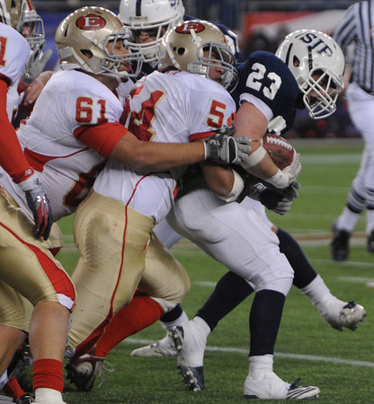 Foxboro:<br /> St. John's Prep's Tyler Coppola has a stack of Everett players on his back at the St. John's Prep vs Everett High School in the Division 1 Super Bowl football game at Gillette Stadium on Saturday.<br /> Photo by Ken Yuszkus/Salem News, Saturday, December 4, 2010.