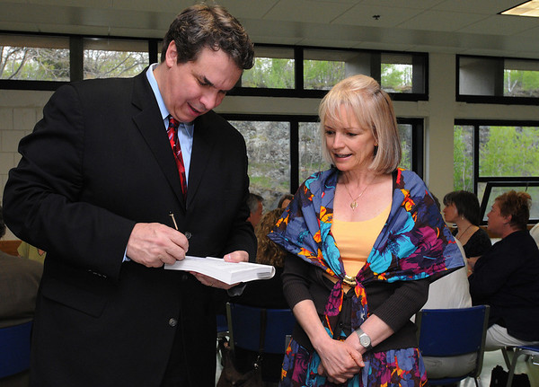 """Salem:<br /> Greg Mortenson, author of the best-selling """"Three Cups of Tea"""", signs Claudia Chuber's copy of his book before he spoke at Salem High School. <br /> Photo by Ken Yuszkus/Salem News, Saturday, May 1, 2010."""